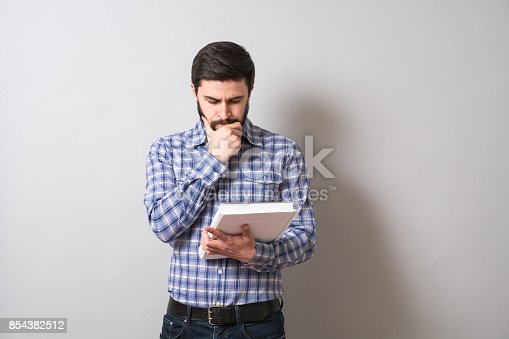 istock Young bearded men with white book 854382512