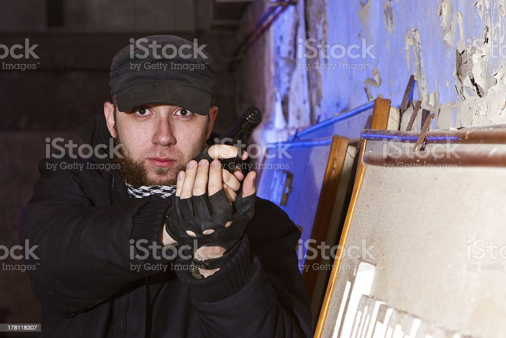 young bearded terrorist with a gun royalty-free stock photo