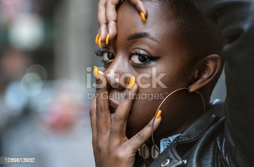 Young beautiful African American female portrait on the street
