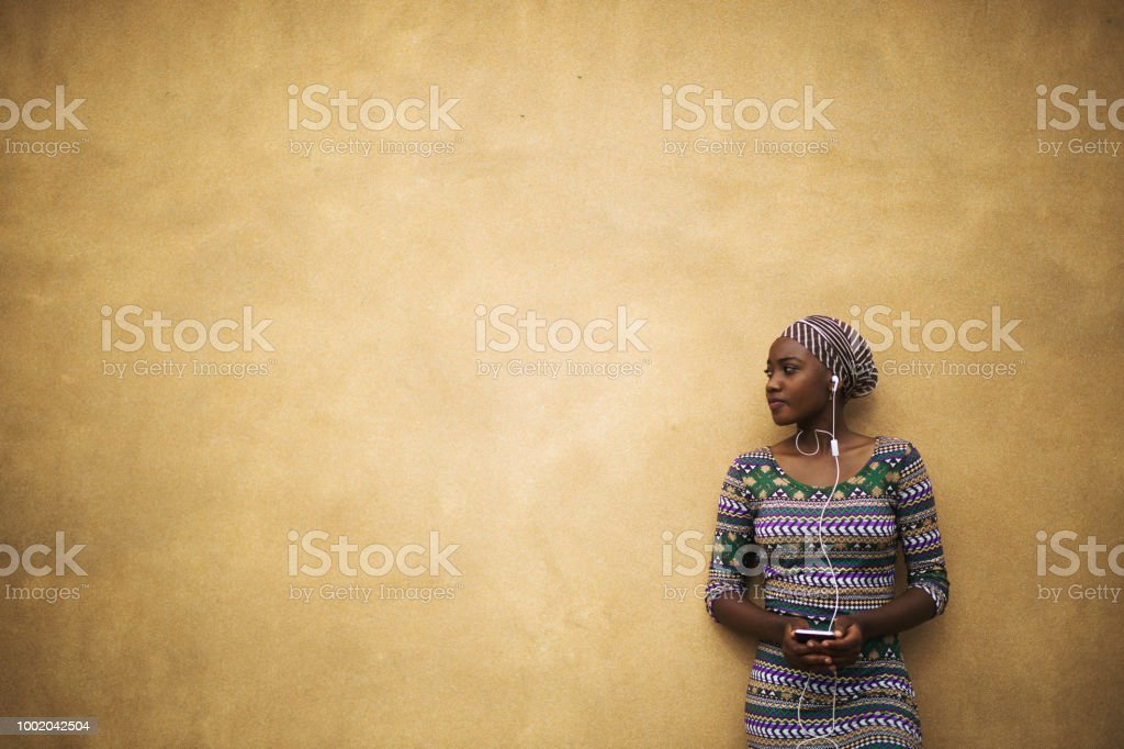 Young Beautiful African Girl Against A Warm Brown Traditional