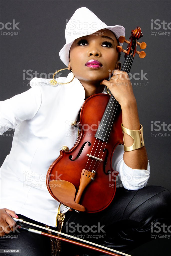 Young Beautiful African Woman Posing With A Violin Stock Photo