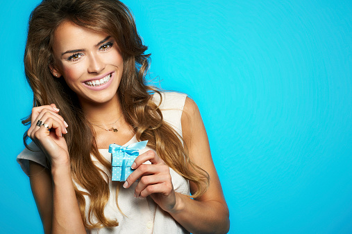 Young Beautiful And Happy Woman With A Gift Stock Photo - Download Image Now