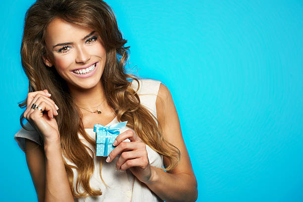 Young beautiful and happy woman with a gift stock photo