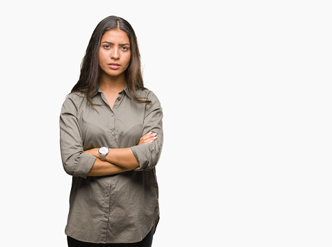 istock Young beautiful arab woman over isolated background skeptic and nervous, disapproving expression on face with crossed arms. Negative person. 1097775692