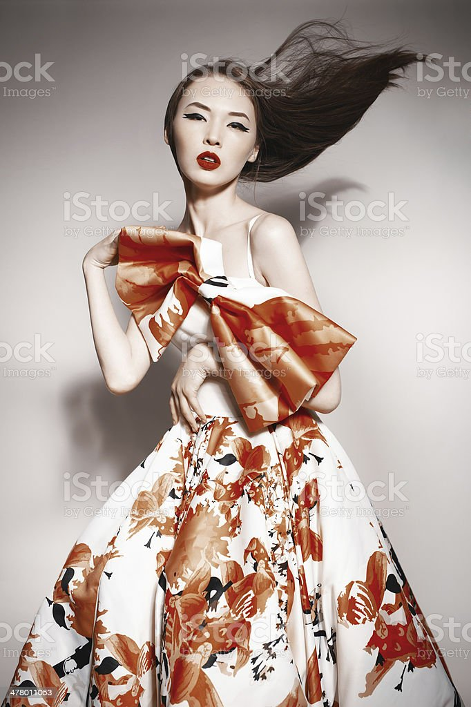 young beautiful asian brunette in gorgeous dress stock photo