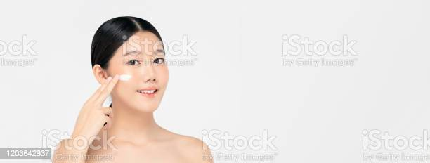 Young beautiful asian woman applying cream to face on banner picture id1203642937?b=1&k=6&m=1203642937&s=612x612&h=wa6brrx9bynvxll5 j05b0a0hobuifgh42cqi36zpf8=