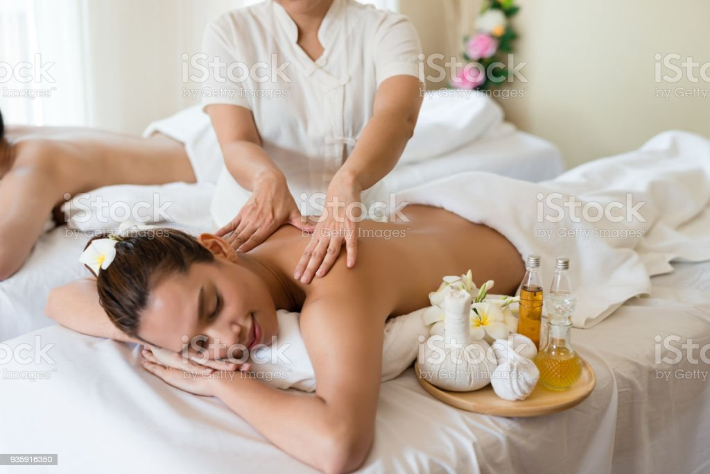 Young beautiful Asian woman relaxing in the spa massage - Stock image .