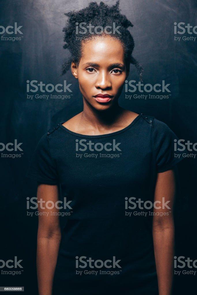 Young beautiful black woman, look at camera stock photo