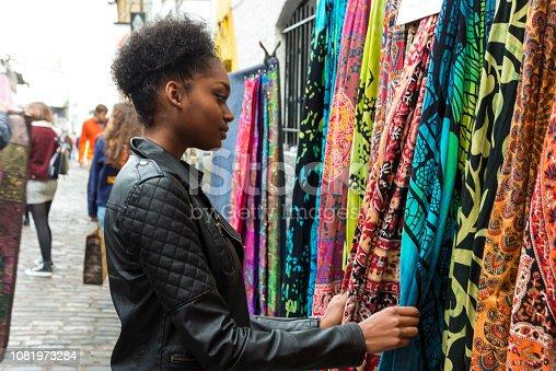 Young black woman shopping at the Camden market, London, UK
