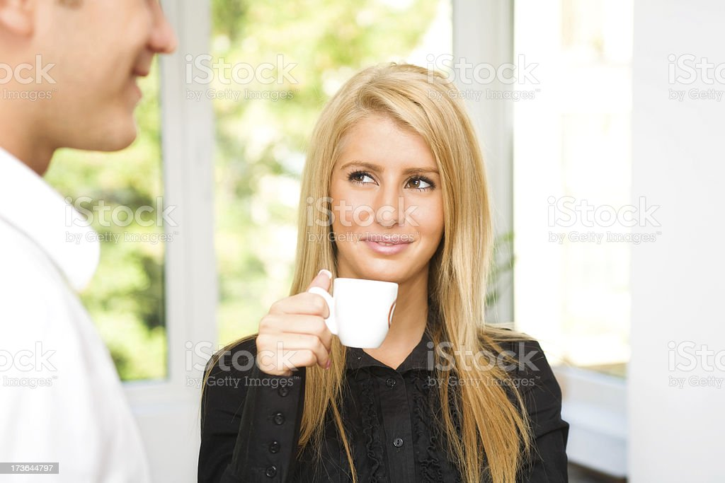 Young beautiful blonde business woman in coffee break royalty-free stock photo