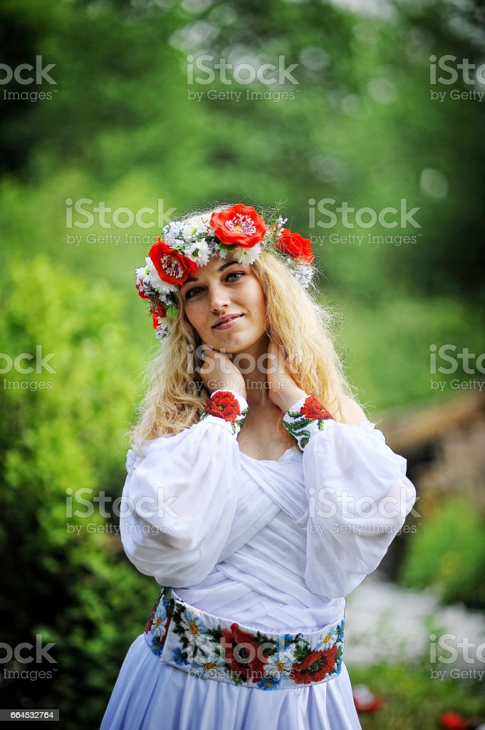 Young  beautiful blonde girl in traditional dress royalty-free stock photo