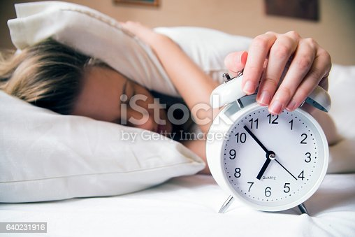 istock Young beautiful blonde woman lying in bed suffering from alarm 640231916