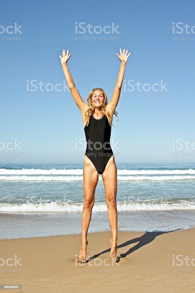 Young beautiful blonde woman making a jump out of joy - Royalty-free Activity Stock Photo