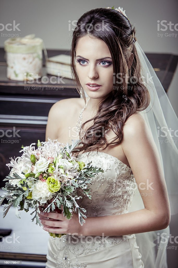 Young beautiful bride holding bouquet of flowers. royalty-free stock photo