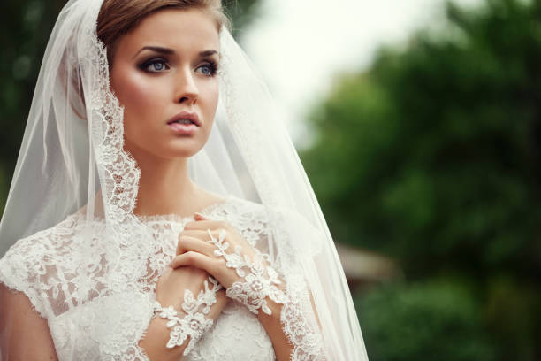 young beautiful bride - veil stock pictures, royalty-free photos & images