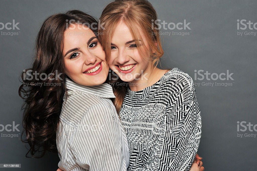 young beautiful brunette and blond haired girls stock photo