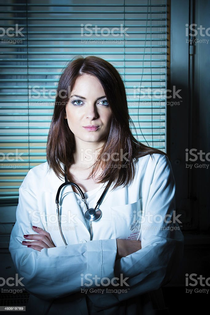 Young beautiful brunette female doctor in the clinic portrait stock photo