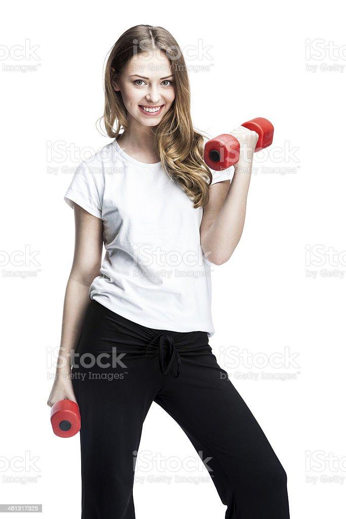 young beautiful brunette girl holding dumbbells stock photo