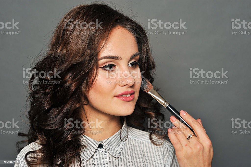 Young beautiful brunette girl in the salon makeup zbiór zdjęć royalty-free