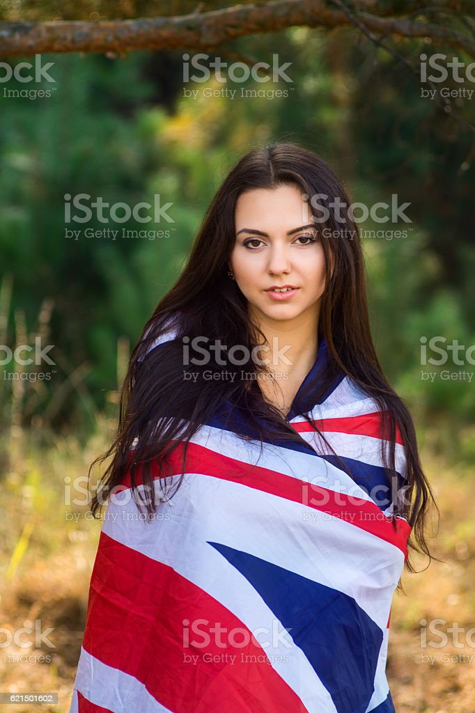 Young beautiful brunette girl posing with a British flag photo libre de droits