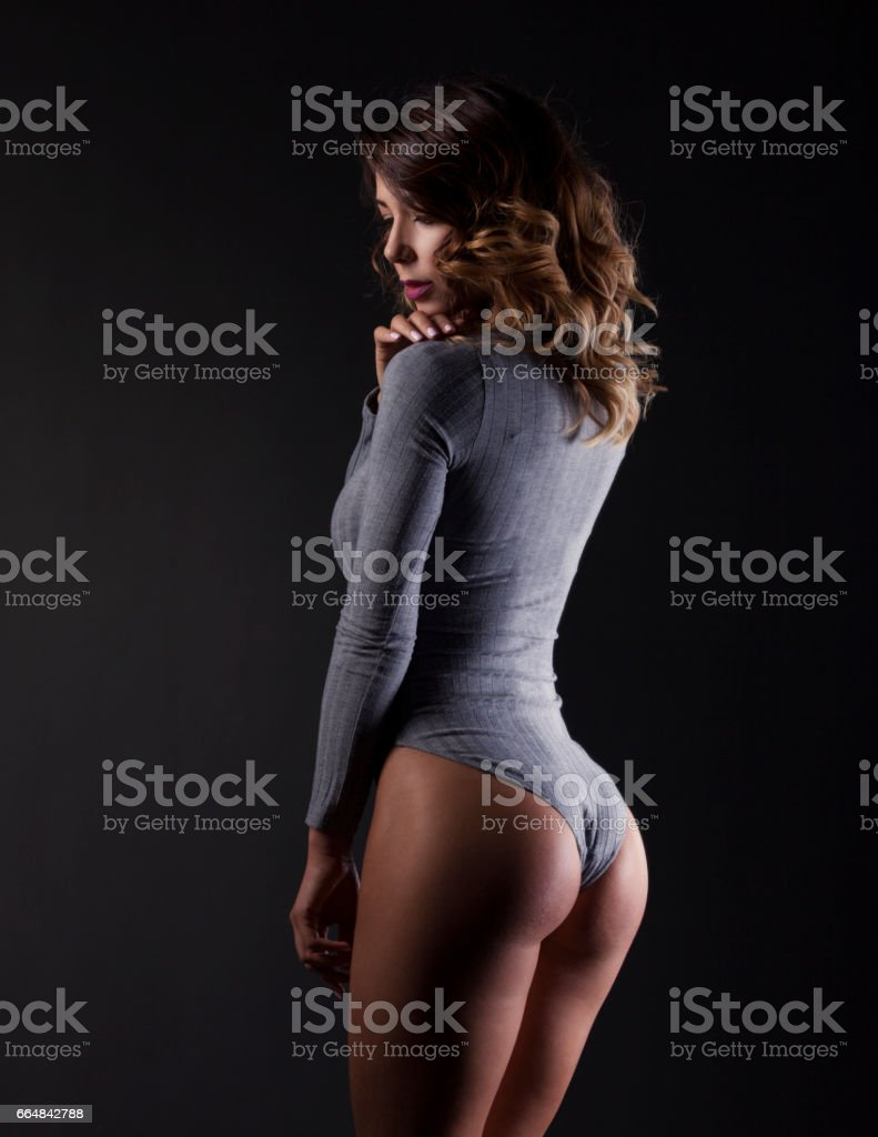 Young beautiful brunette woman with perfect body stock photo