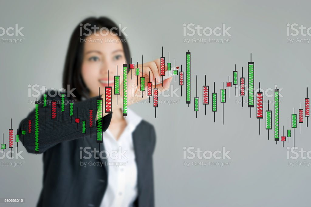 Young beautiful businesswoman drawing a graph stock photo