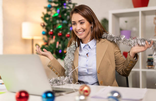 Young beautiful businesswoman having video conference at her home stock photo