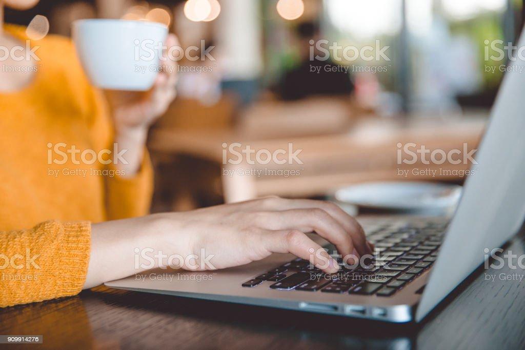 young beautiful businesswomen  wearing a yellow sweater enjoying coffee. royalty-free stock photo
