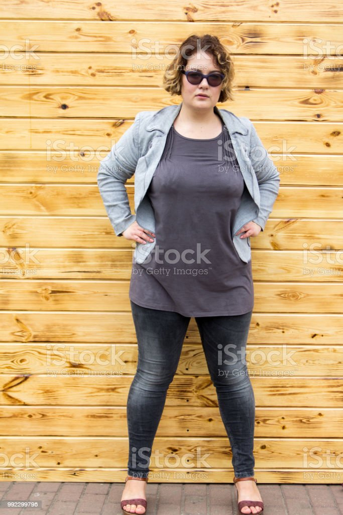 Young Beautiful Busty Curvy Plus Size Model Against The Background ...