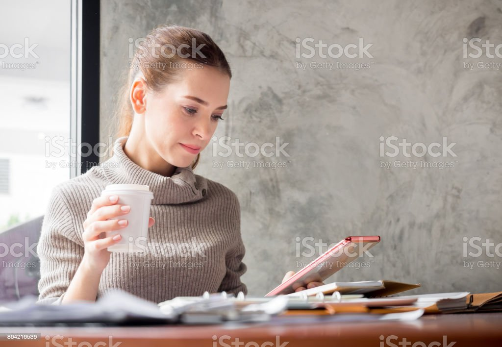 Young beautiful caucasian businesswoman thinking and working on table in a modern office royalty-free stock photo