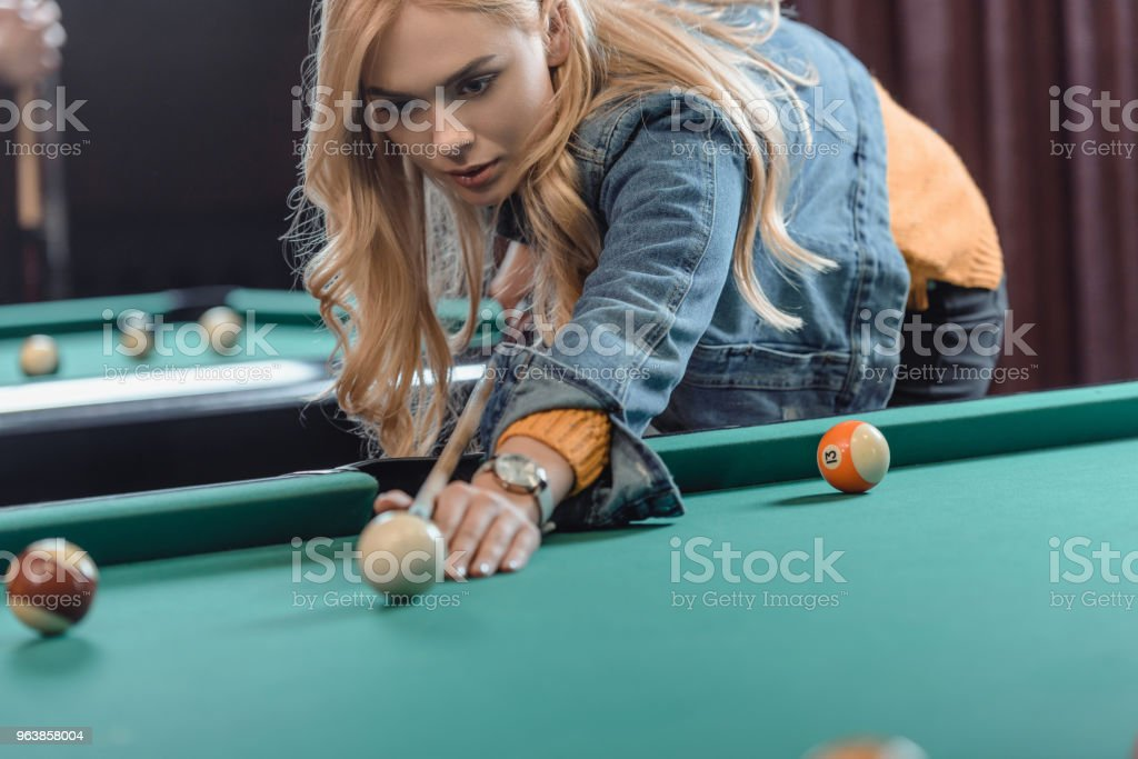 young beautiful caucasian woman playing in pool at bar - Royalty-free Adult Stock Photo