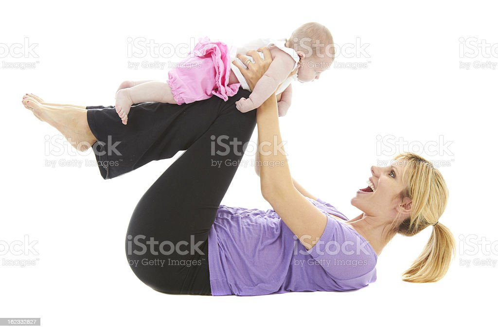 young beautiful caucasion mom doing baby yoga royalty-free stock photo