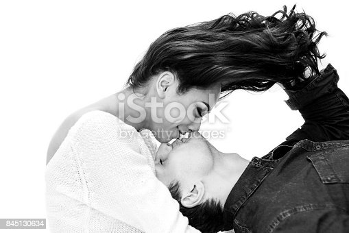 istock Young beautiful couple. Communication between a man and a woman, care, friendship, love, relationship. Black and white photo. Monochrome. 845130634