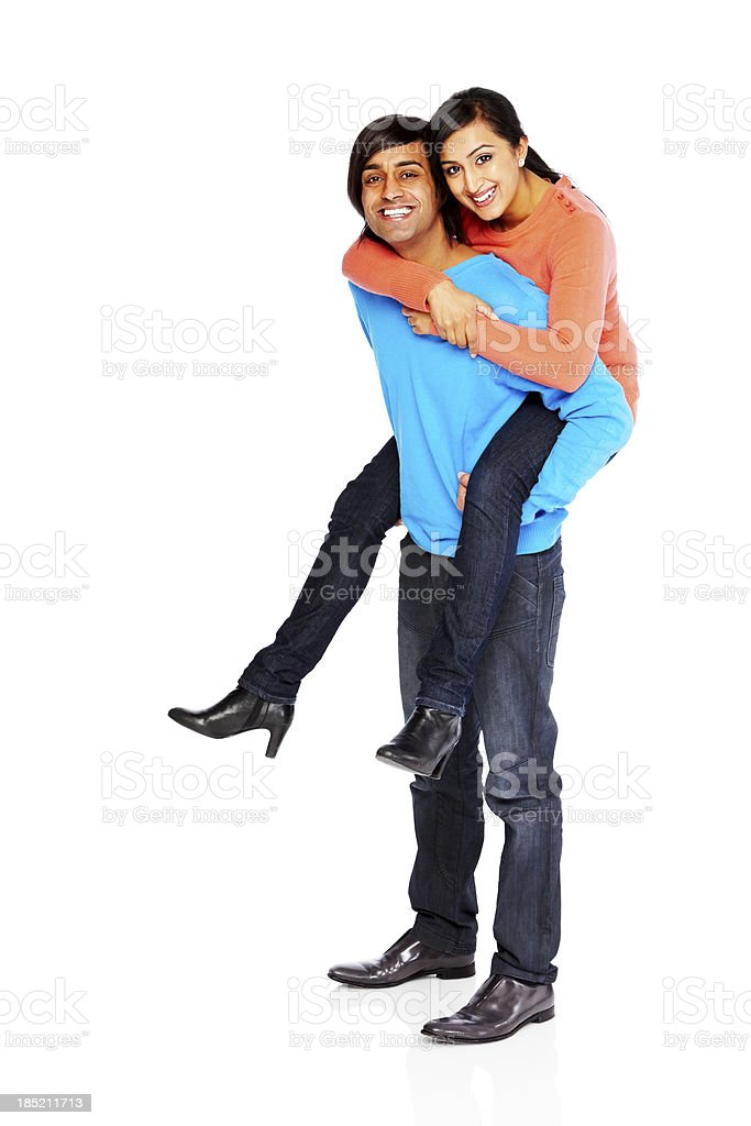 Young beautiful couple having fun together on white royalty-free stock photo