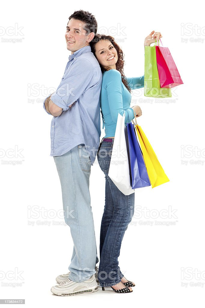 young beautiful couple in love do shopping isolated on white royalty-free stock photo