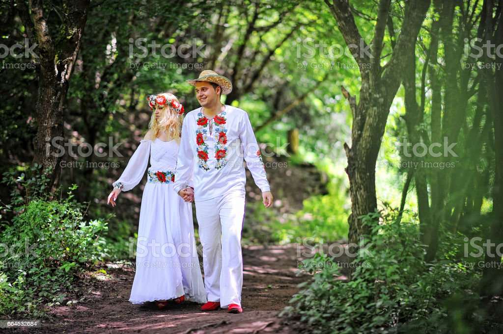 Young  beautiful couple in traditional dress royalty-free stock photo