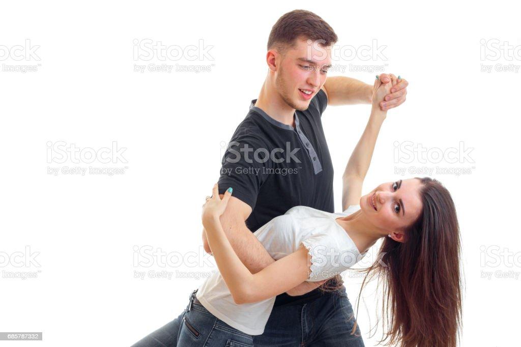 young beautiful couple romantic dance and Guy tips the girl forward foto de stock libre de derechos
