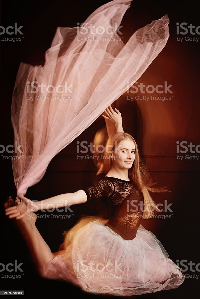 young beautiful dancer girl dancing and jumping, studio stock photo