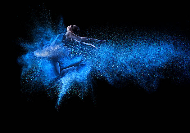 young beautiful dancer jumping into blue powder cloud - performing arts event stock pictures, royalty-free photos & images