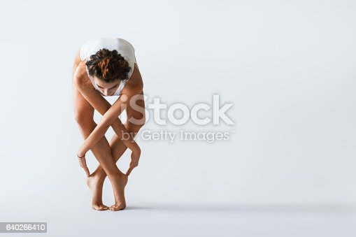 istock Young beautiful dancer posing on a studio background 640266410