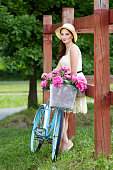 Young beautiful, elegantly dressed woman with retro bicycle. Healthy, cycling.