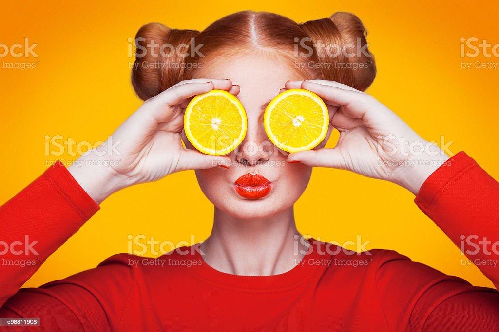 Young beautiful fashion model with Lemon. studio shot.