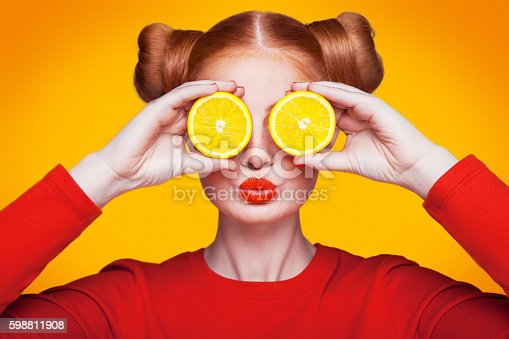 istock Young beautiful fashion model with Lemon. studio shot. 598811908
