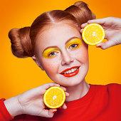istock Young beautiful fashion model with Lemon. studio shot. 598812316