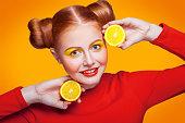 istock Young beautiful fashion model with Lemon. studio shot. 598812534
