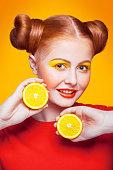 istock Young beautiful fashion model with Lemon. studio shot. 598812718