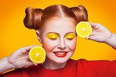 istock Young beautiful fashion model with Lemon. studio shot. 598813024