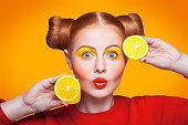 istock Young beautiful fashion model with Lemon. studio shot. 598813272