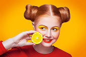 istock Young beautiful fashion model with Lemon. studio shot. 598813644