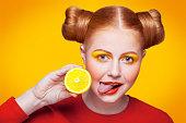 istock Young beautiful fashion model with Lemon. studio shot. 598813948